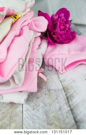 Pink layette for a newborn baby girl with peone