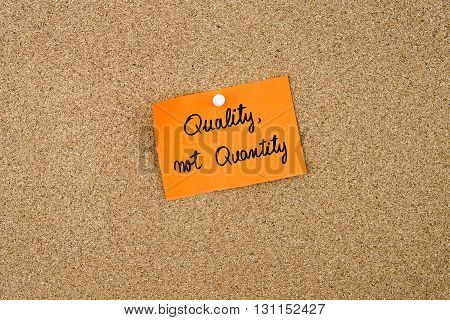 Quality, Not Quantity Written On Orange Paper Note