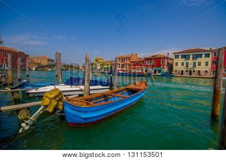 MURANO, ITALY - JUNE 16, 2015: Nice and beautiful picture in Murano harbor with great view of the city, traditional houses.