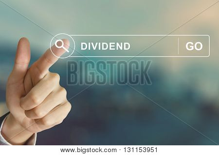 business hand clicking dividend button on search toolbar with vintage style effect