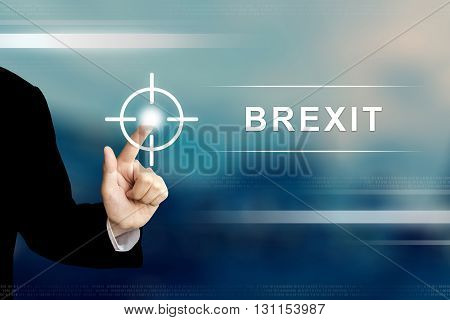 business hand pushing brexit or british exit button on a touch screen interface