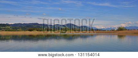 Lake in Zurich Canton Switzerland. Idyllic landscape at Lake Pfaffikon. Spring scene. poster