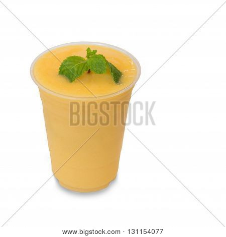 cold fresh mango smoothie in takeaway glass isolated on white background with clipping path