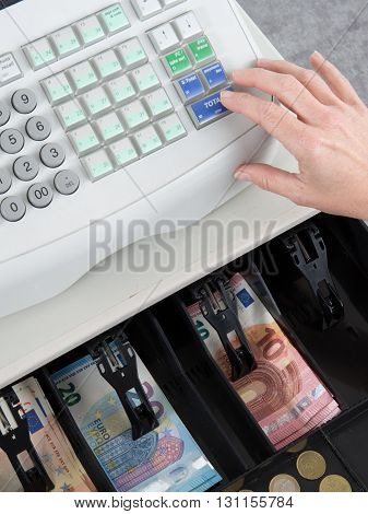 Cash Register And Finger On The Machine