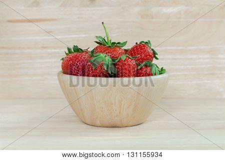 Strawberry. Sweet strawberry. Fresh strawberry. Red strewberry. Ripe red Strawberry on wooden bowl. Strawberry on wooden background.