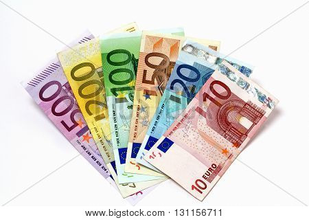 Different euro bills arrayed. Banknotes stacked on each other in different positions.