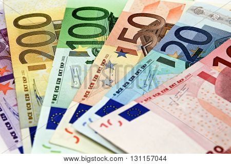 Different Euro Bills Are Spread Out On A Table In The Form Of A Fan
