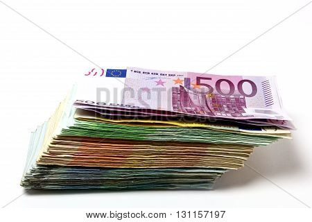Different Euro Bills Are Spread Out On A Table In The Form Of A Stack Of Money.