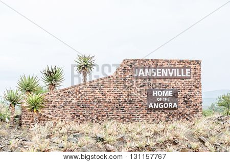 Name board for Jansenville a small town in the heart of the mohair industry of the Eastern Cape Karoo region. Falling rain is visible