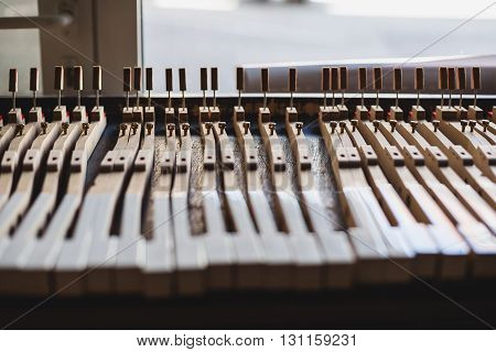 at the piano workshop repair shop for pianoforte