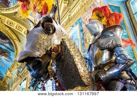 TURIN ITALY - APRIL 25 2016 - Medieval knights on horses in the Royal Armoury of Turin one of the world's most important collections of arms and armour located in the Royal Palace.