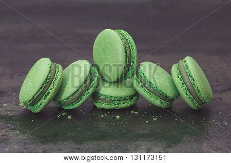Fresh green macarons, close up. Spirulina green tea macaroon with powdered spirulina. Macro, selective focus, vintage toned image, blank space