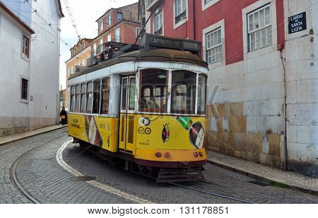 Lisbon, Portugal - March 02, 2016: Vintage Streetcar - Tram in the old streets of the Alfama District Lisbon Portugal