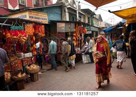 KOLKATA, INDIA - JAN 15, 2013: Aged woman rush to Kalighat Kali Temple for celebration Ganga Sagar Mela on January 15, 2013 in Kolkata India. The name Calcutta to have been derived from the word Kalighat