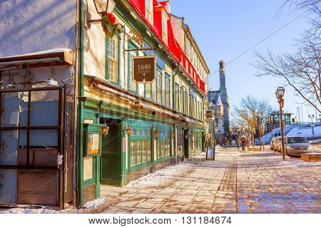 Quebec City Canada - January 21 2016: Tourists shopping and dining along popular streets in Old Quebec City where many historic buildings possess an European charm. Old Quebec City is an UNESCO-designated world heritage site full of historical and religio