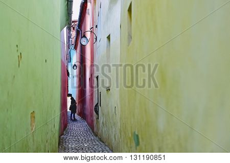 Vintage shot with Rope Street or String Street the narrowest street in Transylvania's Brasov city and one of the narrowest streets in Europe