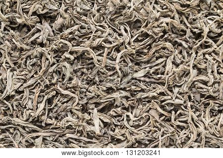 Background from dried leaves of Ceylon black tea close up