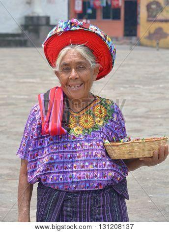 SANTIAGO DE ATITLAN GUATEMALA APRIL 29 2016: Tzutujil woman wearing a traditional toyocal hat. The Mayan people still make up a majority of the population in Guatemala,