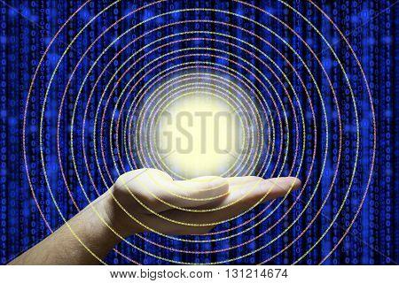 Hand holds a glowing ball emitting circular digital datastreams