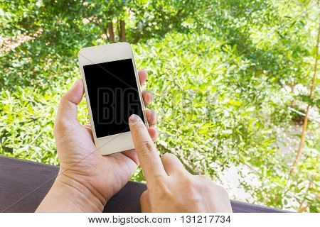 Lady Or Girl Hands Serching Or Surfing Internet Via Cellphone Or Mobile In Relax Mood With Nature Tr