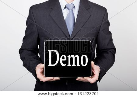technology, internet and networking in business concept - businessman holding a tablet pc with demo sign. Internet technologies in business.