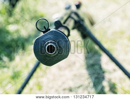 Close up photo of heavy sniper rifle from World War II. Gun scene. Gun barrel. Armed conflict. Military theme. Portable weapon. Shooting position.