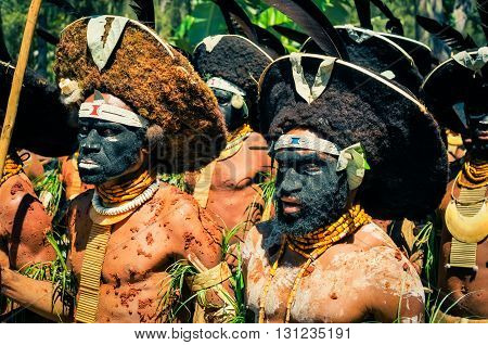 Standing Men In Papua New Guinea