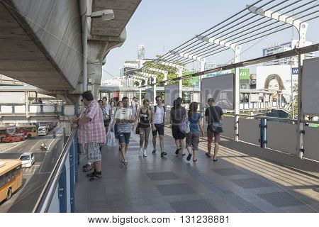BANGKOK THAILAND - APR 24 : tourist walking on skywalk over Pathum Wan Junction near MBK center on april 24 2016 thailand. this skywalk link between BTS National Stadium station and Siam square