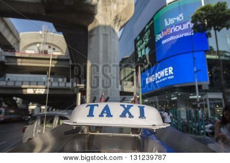 BANGKOK THAILAND - APR 24 : taxi cab sign of tuktuk car at siam square on april 24 2016 thailand. tuktuk is popular taxi service of tourists in bangkok