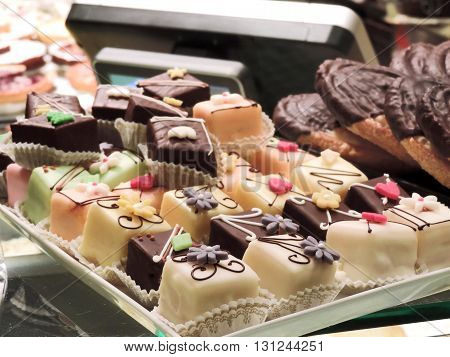 Petit Four in a bakery. Close up shot of little cakes.