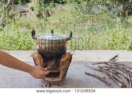 Hand Refill Twig To Fire Stove With Old Aluminium Pot ,dry Limb Pile For Folk Cooking Way