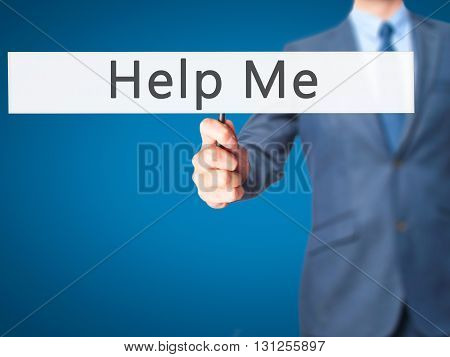 Help Me - Businessman Hand Holding Sign
