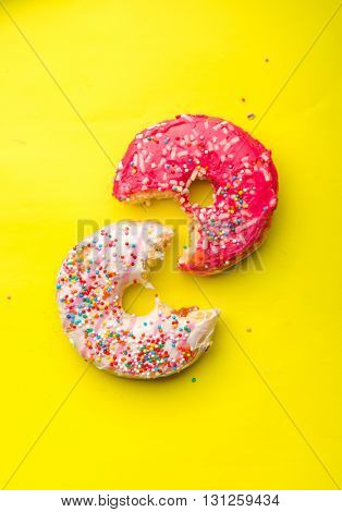 Donuts on yellow background.