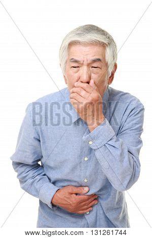 portrait of senior Japanese man feels like vomiting on white background