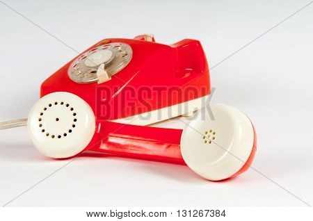 Retro Orange Telephone With Rotary Dial On White