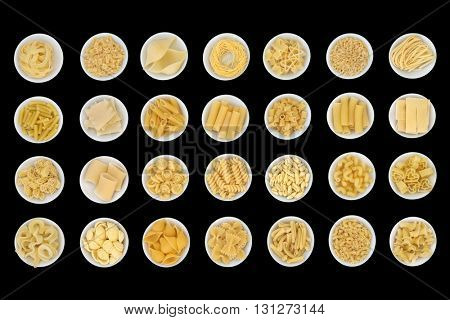 Dried spaghetti pasta food sampler in round porcelain  bowls over black background