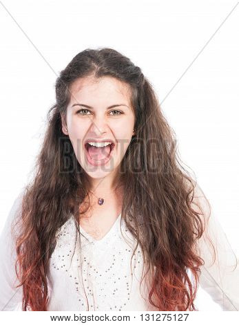 Bully girl shouting and making an aggresive facial expresion
