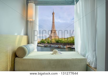 Summer Travel Vacation and Holiday concept - Beautiful Eiffel tower view at window in resort near Seine river Paris France