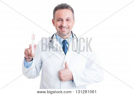 Encouraging Doctor Or Medic Holding Syringe And Showing Like Gesture