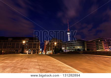 night view from a Spree Bridge to a cityscape of Berlin with Television Tower