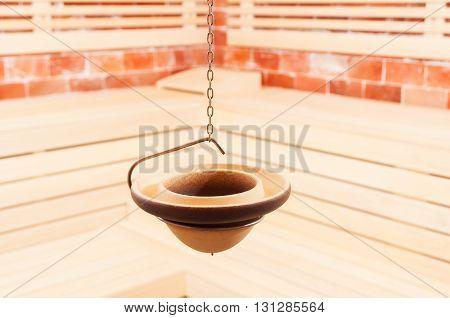 Closeup Of Hanging Vessel In The Salt Sauna
