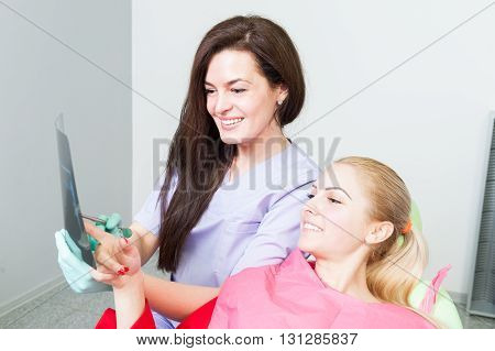 Dentist And Patient Looking At Dental Xray