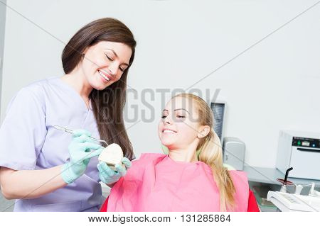 Beautiful Dentist Woman Showing Ceramic Prothesis Crown