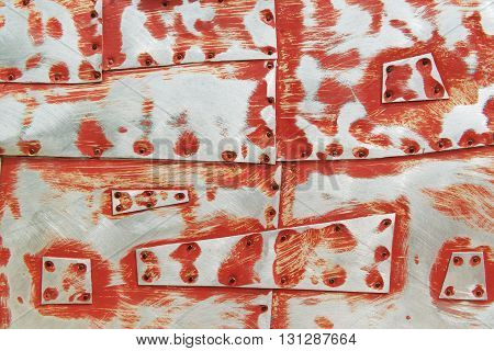 Metal background with scratches red paint and rivets