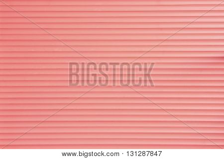 Carmine Background of Roller Door Made of Numerous Narrow Panels