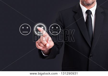 Businessman Hand Pointing The Smiley Face Icon From Screen