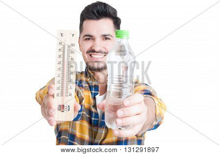 Smiling Male Holding A Bottle Of Water And A Thermometer