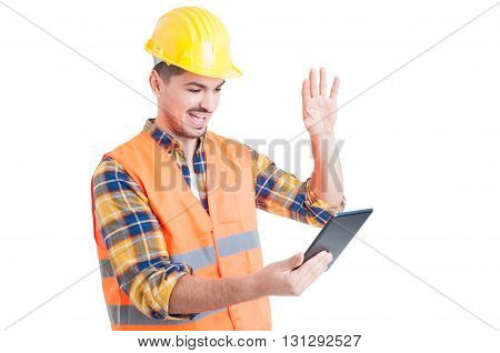 Happy Engineer Rising Hand And Salute While Holding A Tablet