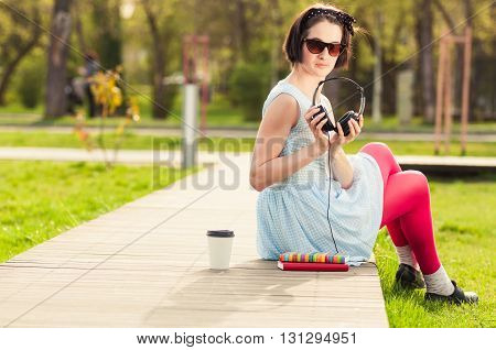 Freetime Concept With Female Relaxing Outdoors With Music And Coffee