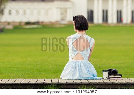 Cute Young Woman With Vintage Dress Standing In The Park